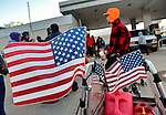 Nov. 3, 2012 - Merrick, New York, U.S. - JOHN GIBSON (wearing orange hat), of Merrick, used a bicycle cart to take gas containers to fill at Hess, one of the Long Island gas stations still open the Saturday after Hurricane Sandy battered this south shore area. U.S. Army National Guard members from Syracuse were at the station to help Nassau County police maintain order in the long lines of people waiting their turn at the pumps. The Freeport Armory in the next town was supposed to have free gas, up to 10 gallons for each car, this day, but people who showed up there were turned away. About 500,000 of the 1.2 million Long Islanders who lost power still didn't have it, and the area continued to suffer from severe damage from floods and wind.