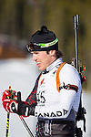 Canadian biathlon athlete Nathan Smith catches his breath after crossing the finish line at The International Biathlon Union Cup # 7 Men's 10 KM Sprint held at the Canmore Nordic Center in Canmore Alberta, Canada, on Feb 16, 2012.  Nathan goes on to win this race, his third win of three sprints held in Canmore.  Two sprints were held the previous weekend in Cup 6.  Photo by Gus Curtis.
