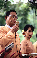 U Tin Oo, then Deputy Chairman of the National League for Democracy (NLD), delivering a speech to supporters alongside Daw Aung San Suu Kyi, Nobel Peace Prize Laureate and General Secretary of the NLD.