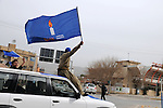 "SULAIMANIYAH, IRAQ:  A man rides down the street waving the flag of the Kurdish ""Change"" party on the first day of official election campaigning...Election workers start their campaigns for the Iraqi Parliamentary Elections due to be held March 7th, 2010...Photo by Pazhar Muhammed/Metrography"
