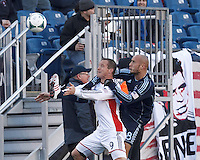 New England Revolution forward Chad Barrett (9) attempts to control the ball as Sporting Kansas City defender Aurelien Collin (78) closely defends.  In a Major League Soccer (MLS) match, Sporting Kansas City (blue) tied the New England Revolution (white), 0-0, at Gillette Stadium on March 23, 2013.