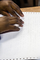 South Africa, Cape Town.  Blind Student Reading Braille with his Fingertips.  Athlone School for the Blind.