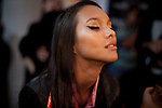A model gets her makeup touched up before the show backstage for the Brazilian brand, Neon, at São Paulo Fashion Week for Summer Season 2013/2014, at Bienal, in São Paulo, Brazil, on Wednesday, March 20, 2013.