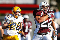 Paul Canevari #22 of Don Bosco runs past Adam North #28 of St Ignatius for a touchdown during the game at Harding Stadium in Steubenville, OH on September 25, 2010. ..Jared Wickerham.