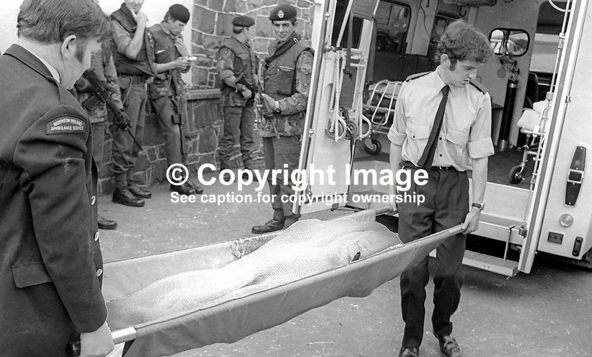 Following a 29th July 1976 explosion at the White Fort Inn, Andersonsontown, Belfast, N Ireland, ambulancemen stretcher away on of the two fatalities.  A third man died from his injuries on 8th September 1976. Approximately 60 men in the bar at the time of who 16 were injured. The attack was attributed to the UVF, Ulster Volunteer Force. 197607290337a<br /> <br /> Copyright Image from Victor Patterson, 54 Dorchester Park, Belfast, UK, BT9 6RJ<br /> <br /> Tel: +44 28 9066 1296<br /> Mob: +44 7802 353836<br /> Voicemail +44 20 8816 7153<br /> Email: victorpatterson@me.com<br /> Email: victorpatterson@gmail.com<br /> <br /> IMPORTANT: My Terms and Conditions of Business are at www.victorpatterson.com