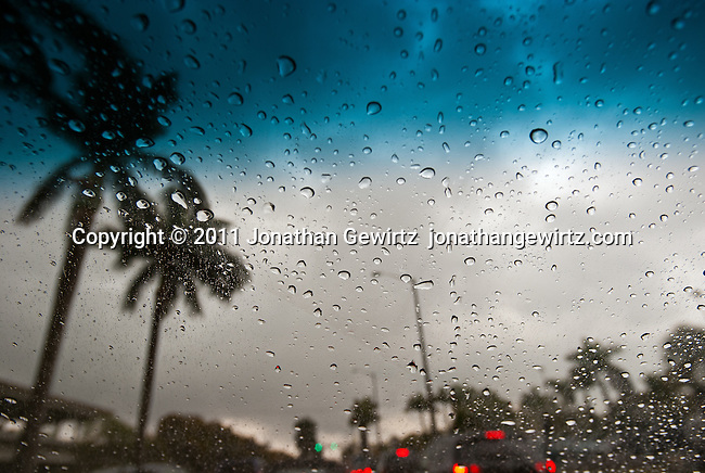 Rainy-day traffic in the tropics as seen through an automobile winshield.