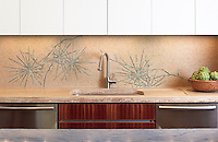 This custom kitchen features a handmade Ikebana mosaic backsplash shown in honed Lagos Gold, Verde Luna, Travertine Noce and polished Topaz Onyx by James Duncan for New Ravenna.<br />