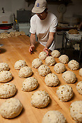 Baker Chris Astraikis sorts through proportioned cuts of buttery-rich dough and rum-soaked raisins with almond slices that will eventually become Stollen, a traditional German holiday treat at Guglhupf Bakery & Påtisserie in Durham, NC, Wednesday, November 30, 2011. Guglhupf Bakery & Påtisserie..Photo by D.L. Anderson