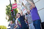 William Hamilton and Ben Gertzfield, above left to right, of Santa Clara wave signs in downtown Mountain View during a march to city hall June 27.  The couple has been engaged for four years, and the Supreme Court's decision to overturn Proposition 8 opens the door for the issuance of marriage licenses in California.