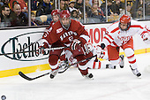 Ryan Grimshaw (Harvard - 6), Dan Ford (Harvard - 5), Matt Nieto (BU - 17) - The Harvard University Crimson defeated the Boston University Terriers 5-4 in the 2011 Beanpot consolation game on Monday, February 14, 2011, at TD Garden in Boston, Massachusetts.
