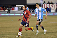 Landon Donovan (10) of the United States is trailed by Angel Di Maria (7) of Argentina. The United States (USA) and Argentina (ARG) played to a 1-1 tie during an international friendly at the New Meadowlands Stadium in East Rutherford, NJ, on March 26, 2011.