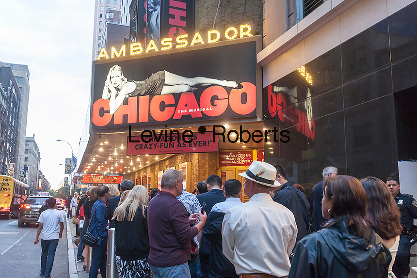 """Theatergoers outside the Ambassador Theatre to see the long-running """"Chicago"""" in New York on Tuesday, May 24, 2016. Once again the 2015-2016 Broadway season was the highest-grossing season in history according the The Broadway League with audience attendance up 1.6 percent over last season and box office grosses up 0.6 percent. (© Richard B. Levine)"""