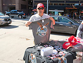 Tino Ferreira, a vendor from Sarasota, Florida, shows off one of the Donald Trump t-shirts that he sells near the Quicken Loans Arena, site of the 2016 Republican National Convention in Cleveland, Ohio on Saturday, July 16, 2016.<br /> Credit: Ron Sachs / CNP<br /> (RESTRICTION: NO New York or New Jersey Newspapers or newspapers within a 75 mile radius of New York City)