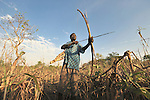 Joseph Lasu hunts in the bush early in the morning in the Southern Sudan village of Kupera. Families here returned from refuge in Uganda in 2006 following the 2005 Comprehensive Peace Agreement between the north and south. Lasu is a United Methodist.