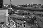 Women on an afternoon walk in Hableh, close to the separation barrier with Matan, seen in background.