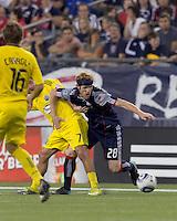 New England Revolution midfielder Pat Phelan (28) struggles to get the ball. The New England Revolution tied Columbus Crew, 2-2, at Gillette Stadium on September 25, 2010.