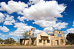 Lining old Route 66 through a small New Mexico town, several long abandoned businesses have been closed since the interstate took the traffic away from the once booming downtown districts.