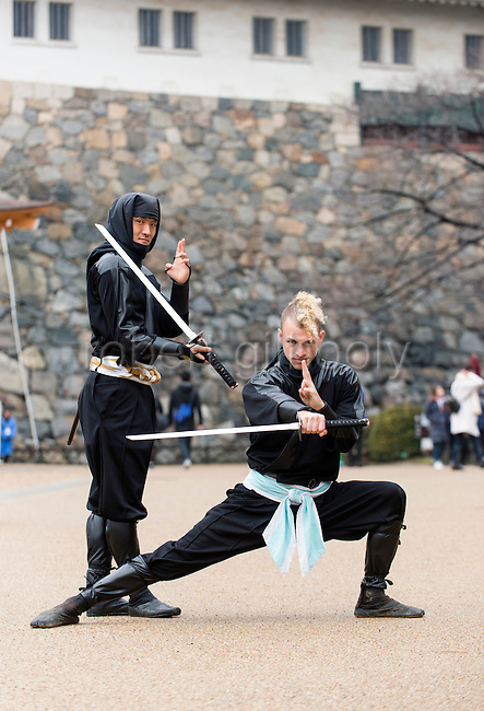 "Chris  ""Sora"" O'Neil and Sanpei pose for a photo in the grounds of Nagoya Castle, Aichi Prefecture Japan on Feb. 23, 2017. O'Neil is one of the eight ninja corps who roam the avenues of the castle and Nagoya Airport, jumping from behind trees and bushes to surprise visitors. ROB GILHOOLY PHOTO"