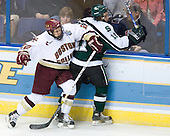 Dan Bertram (Boston College - Calgary, AB) hits Bryan Lerg (Michigan State - Livonia, MI) along the boards. The Michigan State Spartans defeated the Boston College Eagles 3-1 (EN) to win the national championship in the final game of the 2007 Frozen Four at the Scottrade Center in St. Louis, Missouri on Saturday, April 7, 2007.