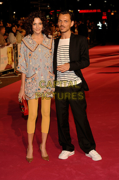 "ASTRID MUNOZ & MATTHEW WILLIAMSON.At the UK Film Premiere of ""Factory Girl"", held at Vue West End Cinema, London, England, March 13th 20007..full length designer black suit white trainers yellow footless tights leggings tunic dress black and white striped top.CAP/PL.©Phil Loftus/Capital Pictures"