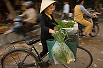 Vieetnamese woman carries produce from Market in Hanoi,Vietnam