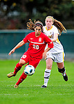 14 October 2010: University of Hartford Hawks forward/midfielder Amelia Pereira, a Sophomore from Madeira Island, Portugal, in action against University of Vermont Catamount midfielder Sarah Coggins, a Sophomore from Cohasset, MA, at Centennial Field in Burlington, Vermont. The Hawks defeated the Lady Cats 6-2 in America East play. Mandatory Credit: Ed Wolfstein Photo