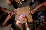 Beijingers play a card game near the Worker's Stadium in Beijing, China on Wednesday, August 6, 2008. The city of Beijing is gearing up for the opening ceremonies of the Olympic Games.  Kevin German