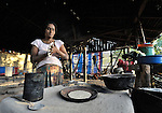 Petronila Escalante prepares tortillas in her family's home in El Bonete, a small village in northwestern Nicaragua. Usually made of corn, the tortilla is a staple in diets throughout Central America and Mexico..
