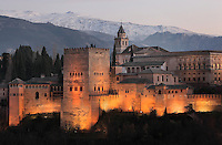 The Comares Tower, built in the 14th century under Muhammad V, the tallest tower in the Alhambra and housing the Hall of the Ambassadors, Nasrid Palaces and the Palace of Charles V in the background, built by Pedro Machuca in the 16th century, Alhambra Palace, Granada, Andalusia, Southern Spain. Behind are the mountains of the Sierra Nevada. The Alhambra was begun in the 11th century as a castle, and in the 13th and 14th centuries served as the royal palace of the Nasrid sultans. The huge complex contains the Alcazaba, Nasrid palaces, gardens and Generalife. Picture by Manuel Cohen