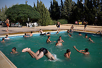 Children play in an open air swimming pool in Mari. The area was later bombed by a Syrian Airforce fighter plane on August 13th. The bombs missed the pool by 20 metres and nobody was injured.