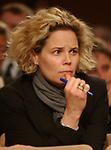 Washington, D.C. - March 23, 2004 -- Kristen Breitweiser of New Jersey, a 9/11 widow, follows the testimony of former Secretary of Defense William Cohen during the hearing of the National Commission on Terrorist Attacks Upon the United States (9/11 Commission) in Washington, DC on March 23, 2004.   <br /> Credit: Ron Sachs / CNP<br /> [RESTRICTION: No New York Metro or other Newspapers within a 75 mile radius of New York City]