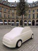 France. Paris. Five fiberglass sculptures from Italian architect and designer Fabio Novembre, inspired by the Fiat 500C model and containing a planted tree, are exhibited on the prestigious Place Vendome in Paris. The exhibition, named 'Un Arbre pour l'Espoir' (A Tree for Hope) will be displaying 12 sculptures from Fabio Novembre, from June 3 to June 29. Since 2005, Designing Hope project has been using  contemporary art as a tool to create awareness in its fight against HIV and Aids-related discrimination. Place Vend&ocirc;me is a square in the 1st arrondissement of Paris. Its regular architecture by Jules Hardouin-Mansart and pedimented screens canted across the corners give the rectangular Place Vend&ocirc;me the aspect of an octagon. 12.06.10 &copy; 2010  Didier Ruef