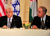 "United States Special Envoy to the Middle East George Mitchell, right, listens as President Mahmoud Abbas of the Palestinian Authority, left, makes remarks at the ""Relaunch of Direct Negotiations Between the Israelis and Palestinians"" in the Benjamin Franklin Room of the U.S. Department of State on Thursday, September 2, 2010.  .Credit: Ron Sachs / CNP.(RESTRICTION: NO New York or New Jersey Newspapers or newspapers within a 75 mile radius of New York City)"
