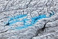 Aerial view of crevasses and melt water ponds on Kinik Glacier, Alaska, USA