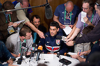 USA's Claudio Reyna gives interviews during a media mixed zone in Hamburg, Germany, for the 2006 World Cup, June, 9, 2006.
