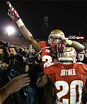 Linebackers Lamarcus Joiner (20) and Telvin Smith celebrate winning the BCS national title game at the Rose Bowl in Pasadena, California on January 6, 2014.  Florida State Seminoles defeated the Auburn Tigers 34-31.