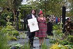 Laurence Llewelyn-Bowen &amp; Wife Jackie unveils the seed packet he has decorated to support the new RHS campaign - Greening Grey Britain. Pictures on the RHS garden at Chelsea flower Show. <br /> <br /> 18.5.15<br /> Bethany Clarke / RHS