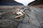 A car lies flattened after the mega-tsunami in Minami-Sanriku, a coastal town in Miyagi Prefecture, Japan on 14 March, 2011. Around 10,00 of the town's 17,000 population are reported as either dead or missing. Photographer: Robert Gilhooly