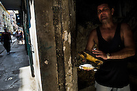 A Cuban man, hidden in the dark house portal, sells illegaly living turtles for a soup in Havana, Cuba, 11 February 2009. About 50 years after the national rebellion, led by Fidel Castro, and adopting the communist ideology shortly after the victory, the Caribbean island of Cuba is the only country in Americas having the communist political system. Although the Cuban state-controlled economy has never been developed enough to allow Cubans living in social conditions similar to the US or to Europe, mostly middle-age and older Cubans still support the Castro Brothers' regime and the idea of the Cuban Revolution. Since the 1990s Cuba struggles with chronic economic crisis and mainly young Cubans call for the economic changes.