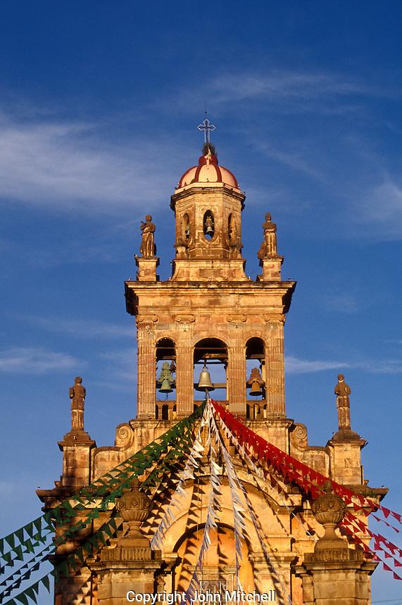 The Templo El Santario steeple decorated with red white and green streamers for the Dia de la Revolucuion (November 20) celebrations, Patzcuaro, Michoacan, Mexico