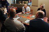 United States President Barack Obama (C) has lunch with winners of a campaign contest, at Scion Restaurant in Washington DC, USA, on 06 January 2012..Credit: Michael Reynolds / Pool via CNP