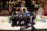 Detail of empty beer bottles during a bout between Hellcats and Putas del Fuego at Palmer Events Center in Austin, Texas.