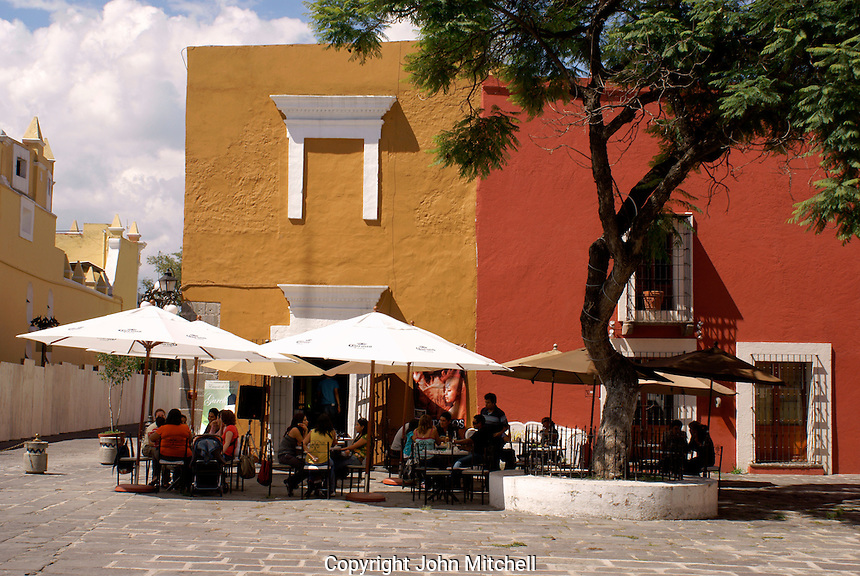 People in an outdoor cafe  in the Barrio del Artista  in the city of Puebla, Mexico.