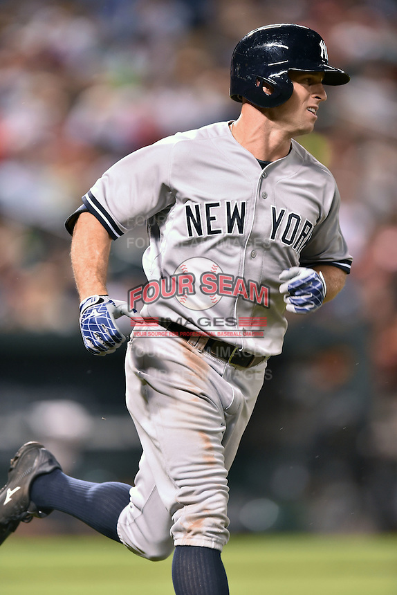 New York Yankees left fielder Brett Gardner #11 runs to first during a game against the Baltimore Orioles at Oriole Park at Camden Yards August 11, 2014 in Baltimore, Maryland. The Orioles defeated the Yankees 11-3. (Tony Farlow/Four Seam Images)