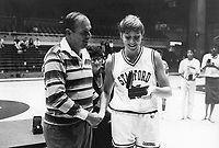 30 December 1986: Athletic Director Andy Geiger shakes hands with Katy Steding during the Lucky Cardinal Classic.