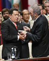 "Venezuelan President Hugo Chavez, left, and President Fidel Castro, smile while in the ""Karl Marx"" Theater,  in Havana, Cuba Tuesday Aug. 20, 2005.  Credit: Jorge Rey/MediaPunch"