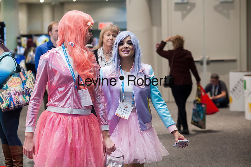 Models in costume dressed as Shibajuku Girls work the floor at the 114th North American International Toy Fair in the Jacob Javits Convention center in New York on Sunday, February 19, 2017.  The four day trade show with over 1000 exhibitors connects buyers and sellers and draws tens of thousands of attendees.  The toy industry generates over $26 billion in the U.S. alone and Toy Fair is the largest toy trade show in the Western Hemisphere. (© Richard B. Levine)