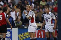 February 14 2009, San Diego, CA, USA:  Matt Hawkins of the USA team makes a point to Morgan Williams of Canada as teammate Paul Emerick listens in during the IRB USA Sevens Tournament at Petco Park in Downtown San Diego.  Both Hawkins and Emerick have played for OMBAC Rugby club based at Robb Field in Ocean Beach.