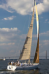 Sailboat Sugar Magnolia J-120 sailing on the Charleston Harbor and battery near the cooper river bridge