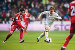 Luka Modric of Real Madrid fights for the ball with Sergio Escudero Palomo of Sevilla FC during their Copa del Rey Round of 16 match between Real Madrid and Sevilla FC at the Santiago Bernabeu Stadium on 04 January 2017 in Madrid, Spain. Photo by Diego Gonzalez Souto / Power Sport Images